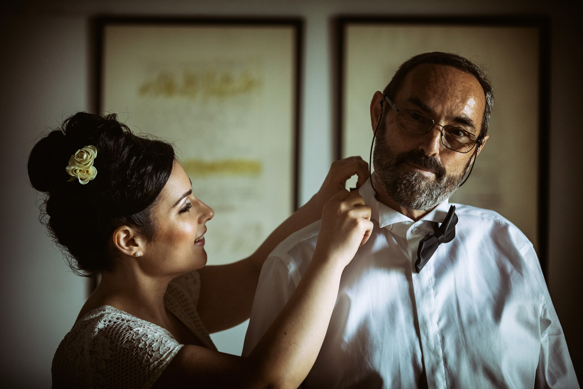 the bride fixing her father's tie in a picture by Fabio Schiazza