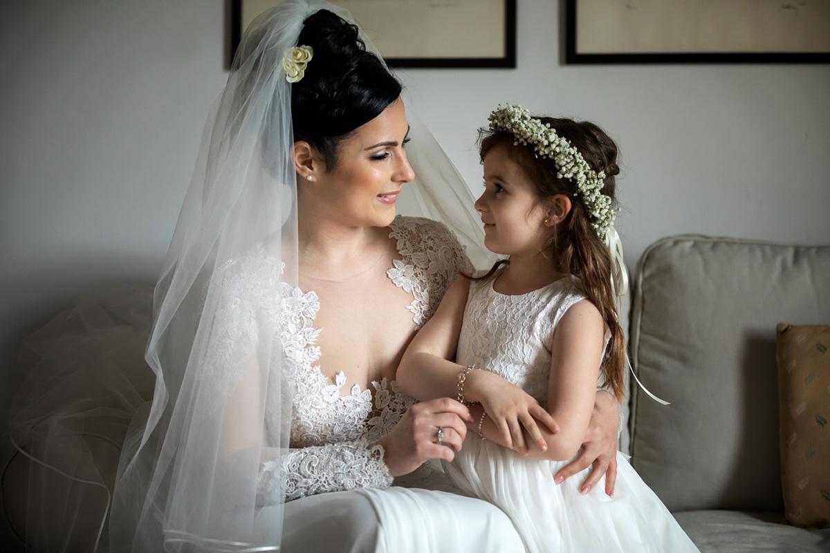 the bride hugging the child in a picture by Fabio Schiazza