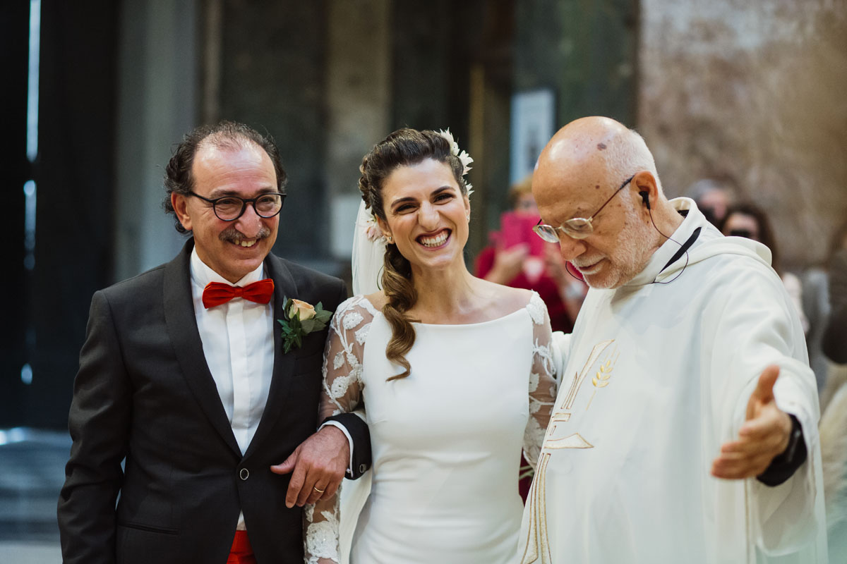 the bride, her father and the priest in a pic by Fabio Schiazza